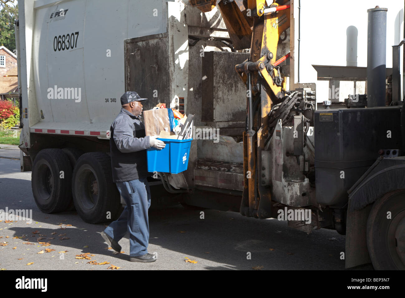Detroit, Michigan - A city worker collects materials for recycling from a home on Detroit's east side. - Stock Image