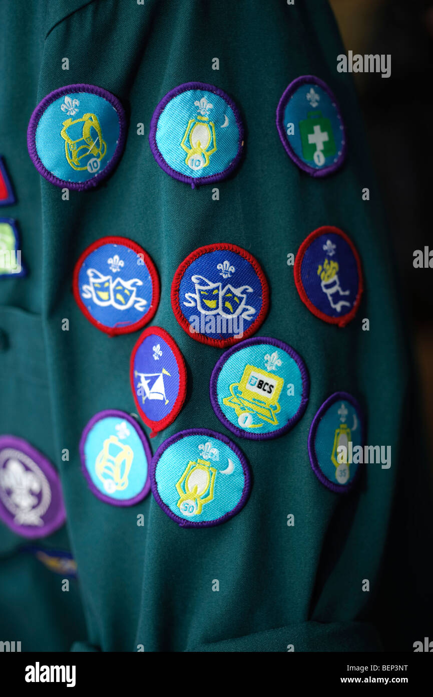 A Boy scout with merit badges on the arm of his uniform, UK - Stock Image