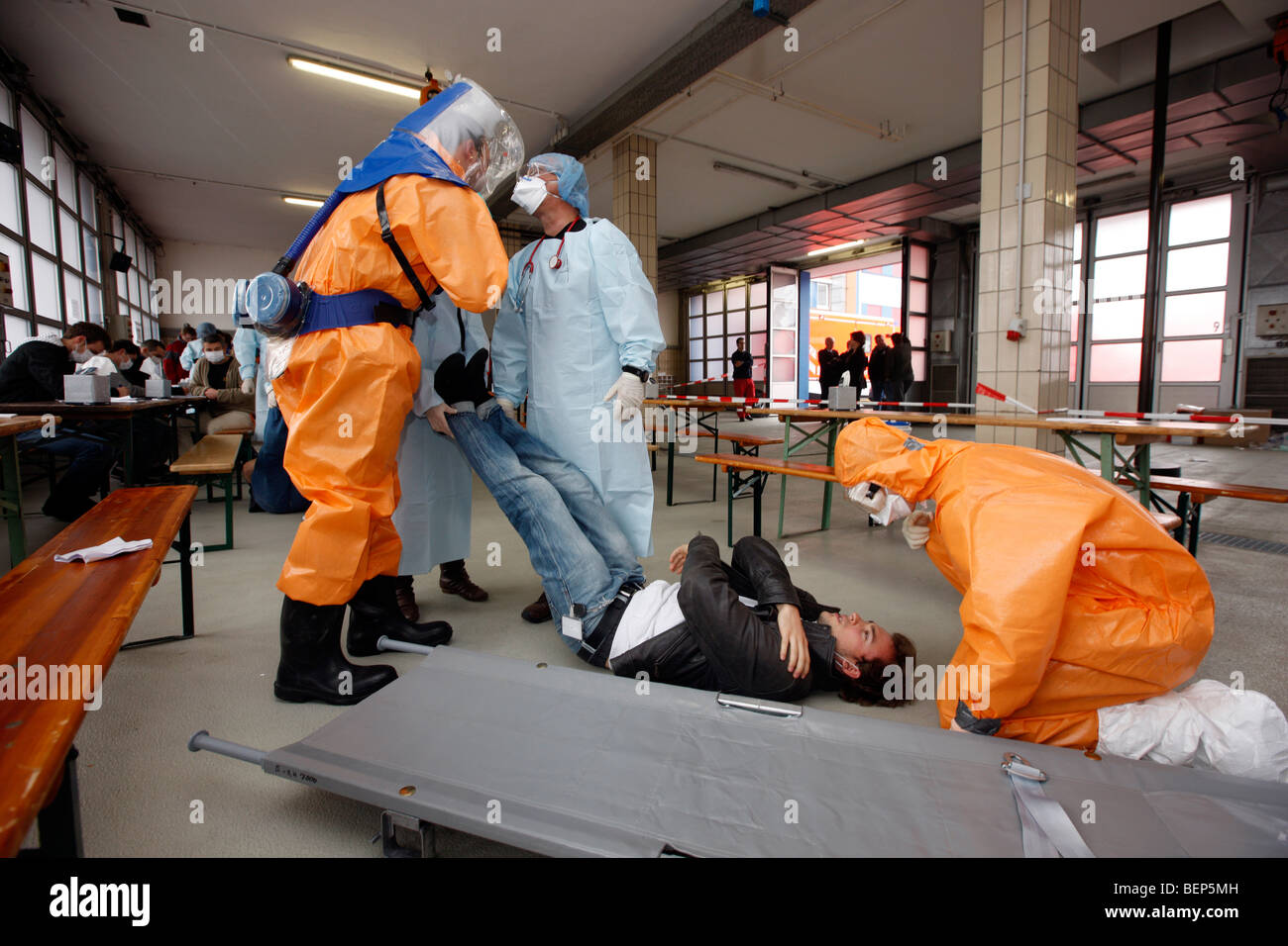 Exercise of a fire brigade, mass vaccination of people against a virus, pandemic exercise, Essen, Germany. - Stock Image