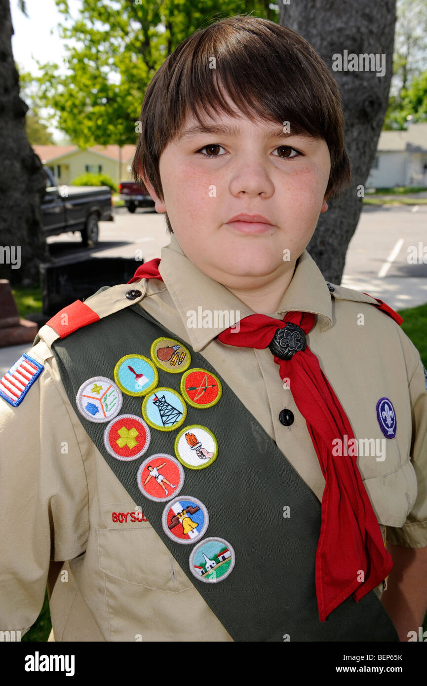 Boy scout in uniform with honor badges - Stock Image