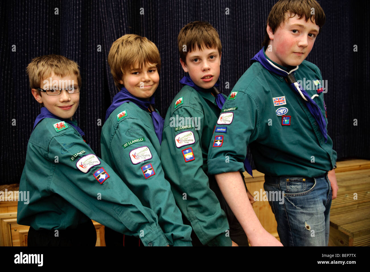 Four young First Llanelli Boy Scouts in their clubhouse renovated with money from the Big Lottery Fund. - Stock Image