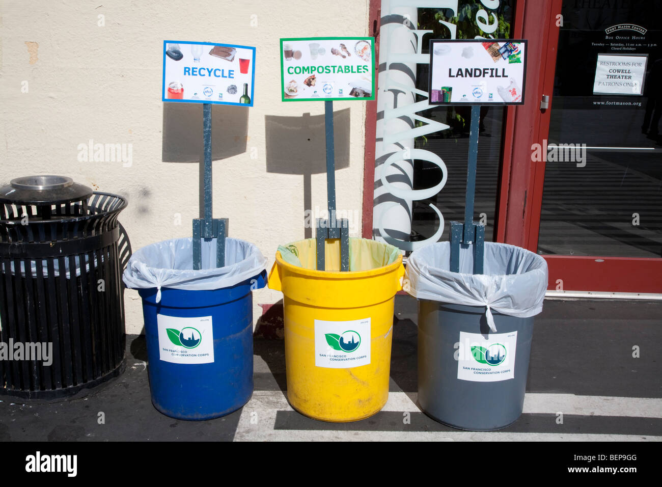 Garbage bins for recycling, composting, and landfill waste at a conference encourage people to sort their trash - Stock Image