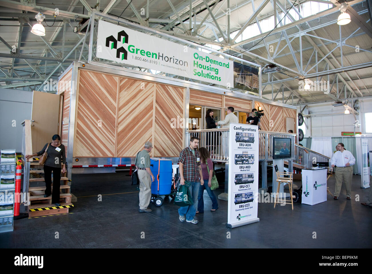 Green Horizon Manufacturing green building portable, on-demand emergency housing on display at exposition. United - Stock Image