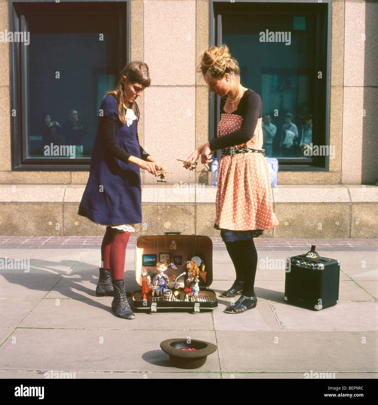 Female puppeteers with their rock band puppets busking on the streets of London England UK  kathy dewitt - Stock Image