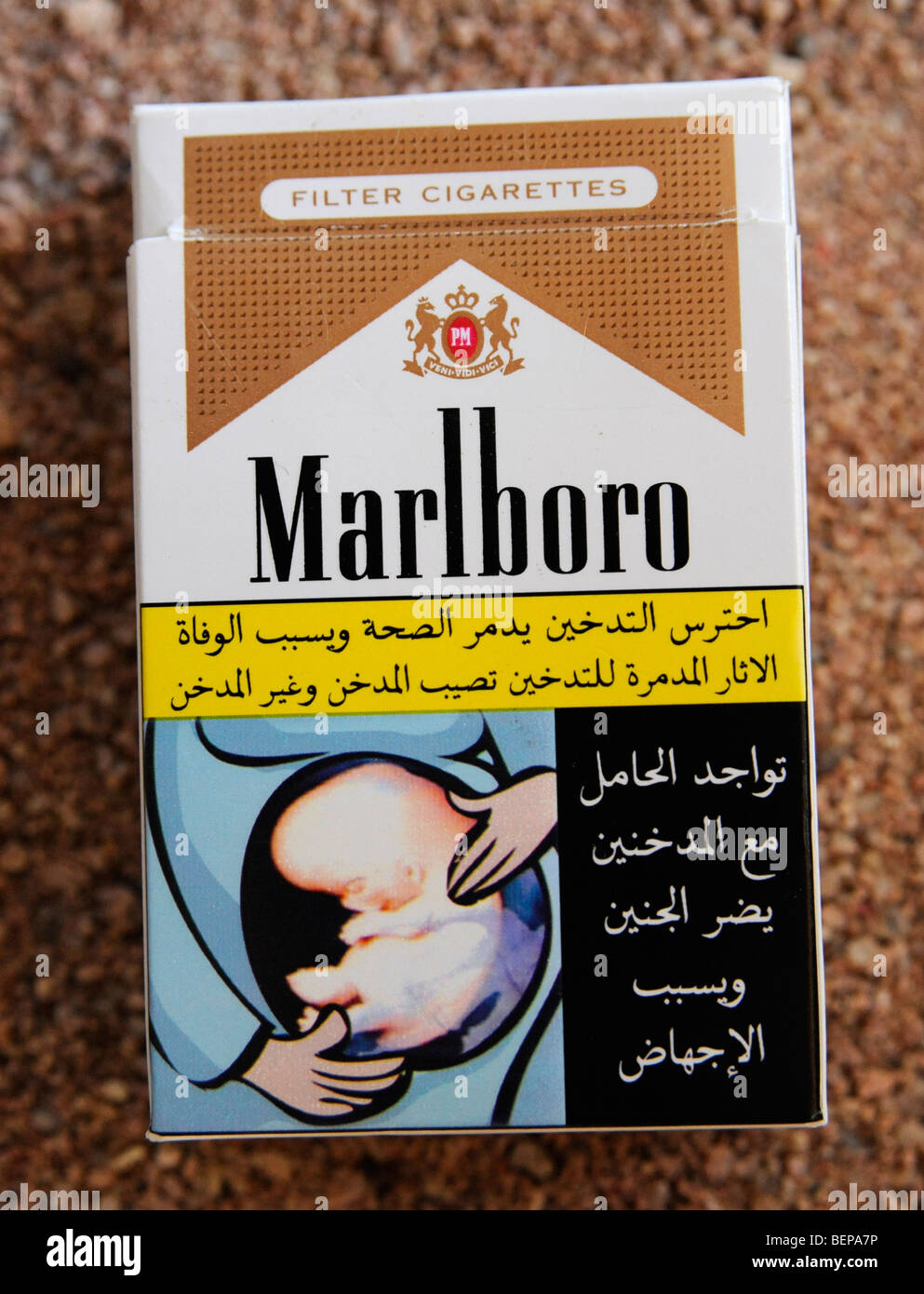 A health warning in arabic on a packet of Marlboro cigarettes - Stock Image