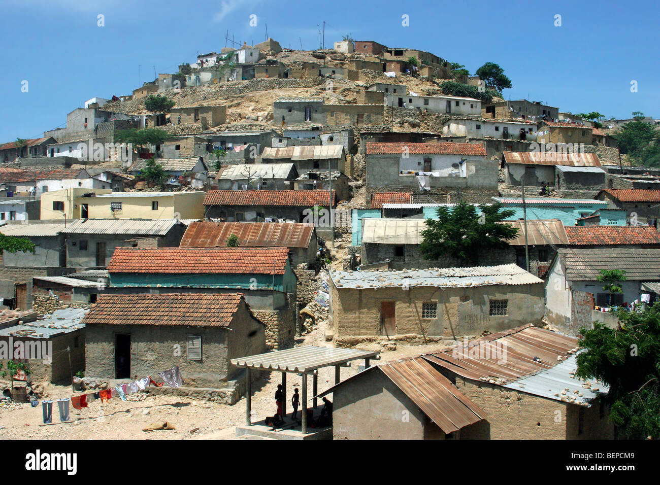 Brick houses on hill of suburb of Lobito, Angola, Southern Africa - Stock Image