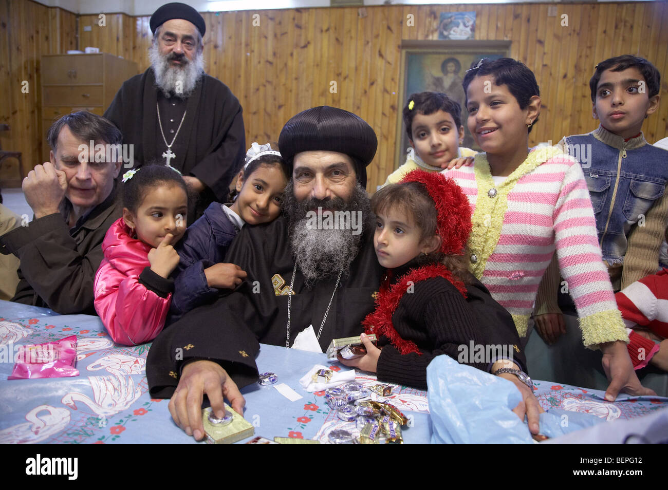 EGYPT Marina House in Port Said.  Bishop Tadros visiting the home and distributing sweets to those who attended - Stock Image