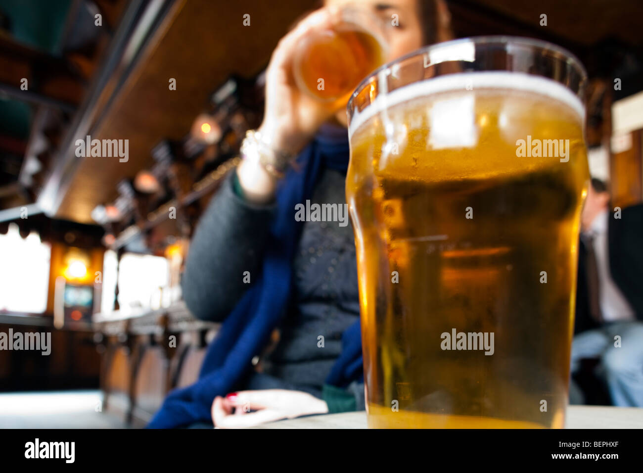 Pint of beer in a pub, London, England, United Kingdom - Stock Image