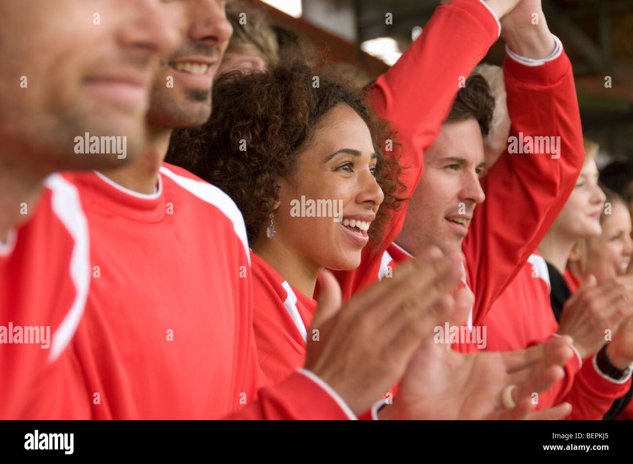 Fans clapping at football match - Stock Image