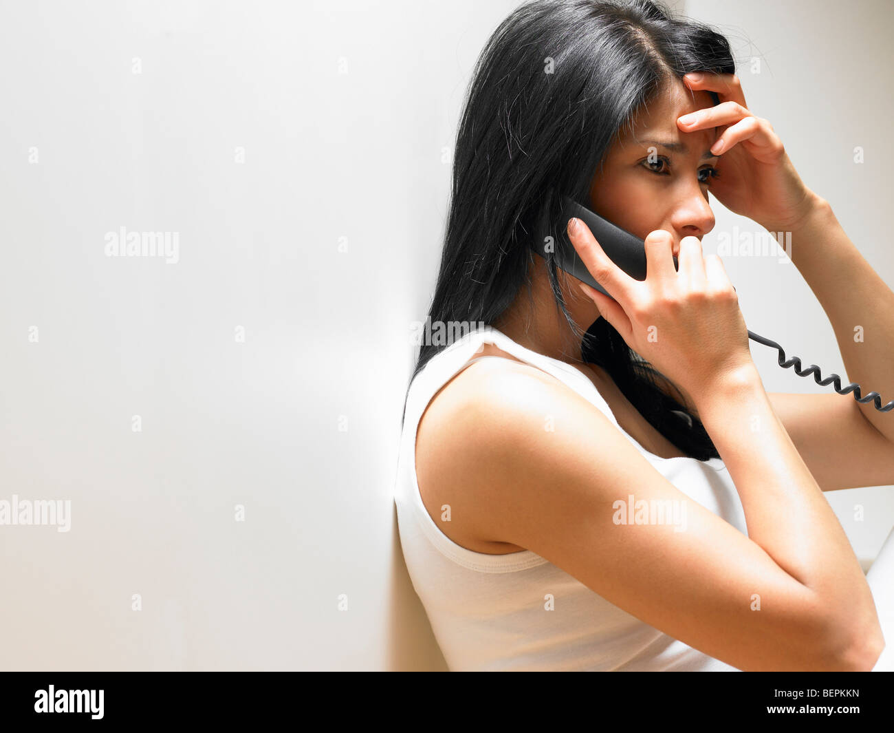 Woman on the phone, anxious - Stock Image