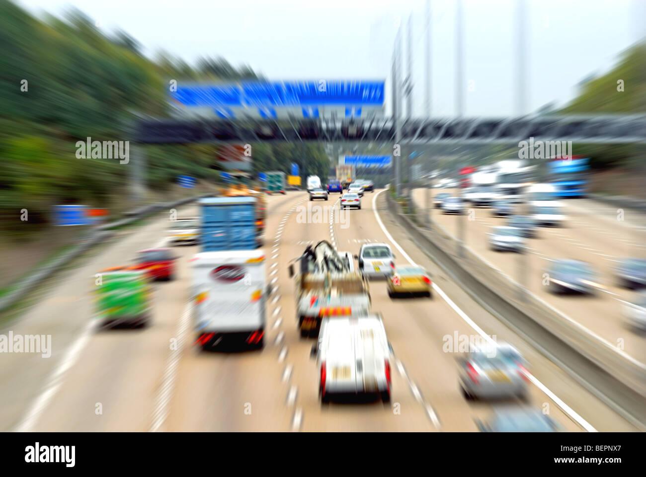 Fast moving traffic on M25 motorway,Surrey - Stock Image