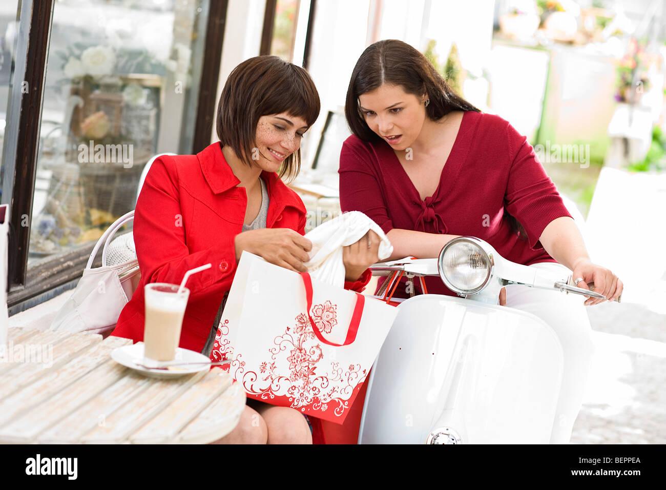girlfriends meet in a street cafe - Stock Image