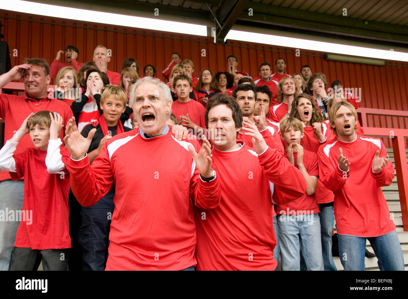Group of frustrated football supporters - Stock Image