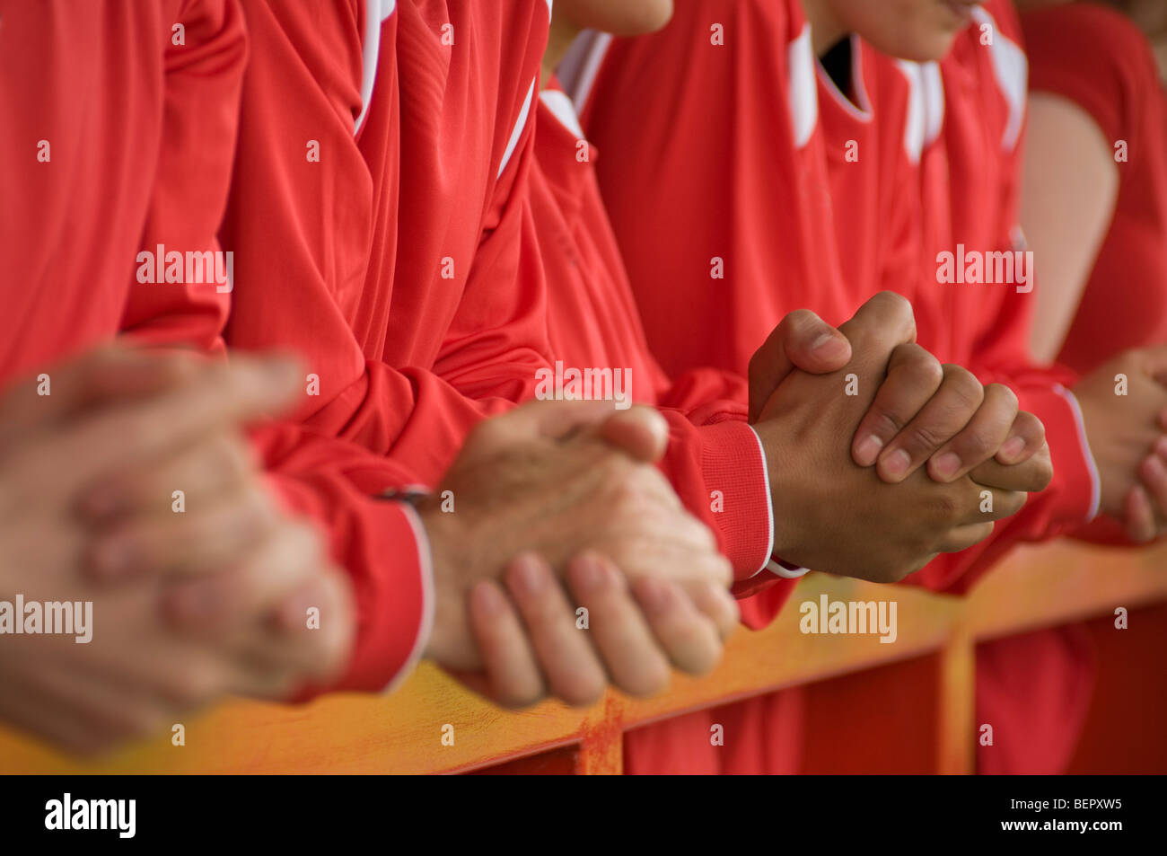 Close up of football supporters hands - Stock Image