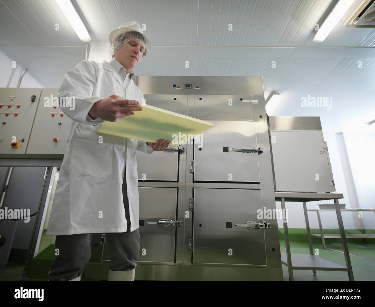 Food Worker With Cutting Board - Stock Image