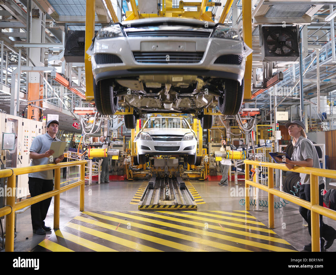 Car Workers Inspecting Production Line - Stock Image