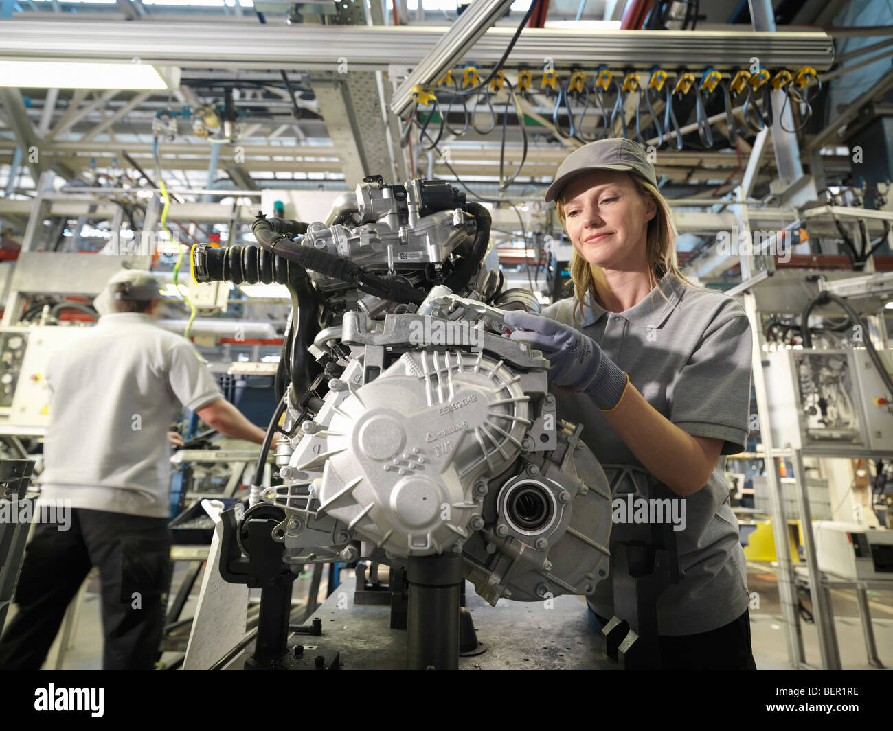 Car Workers Building Car Parts - Stock Image