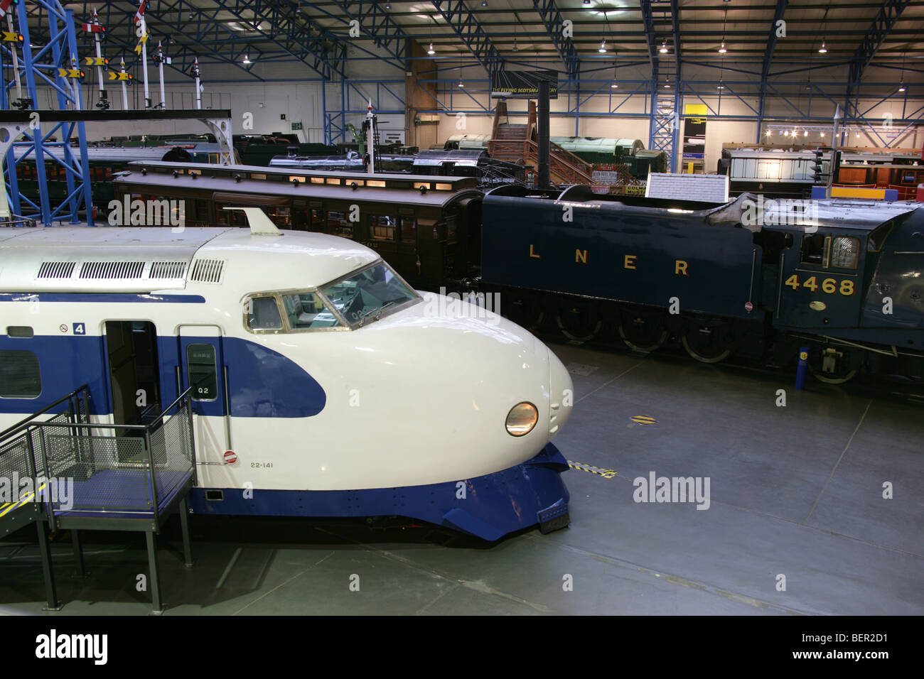The Shinkansen Bullet Train with the Mallard locomotive in the background at the National Railway Museum's Great - Stock Image