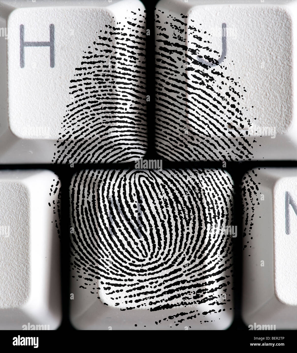 fingerprint on keyboard key illustrating identity theft Stock Photo