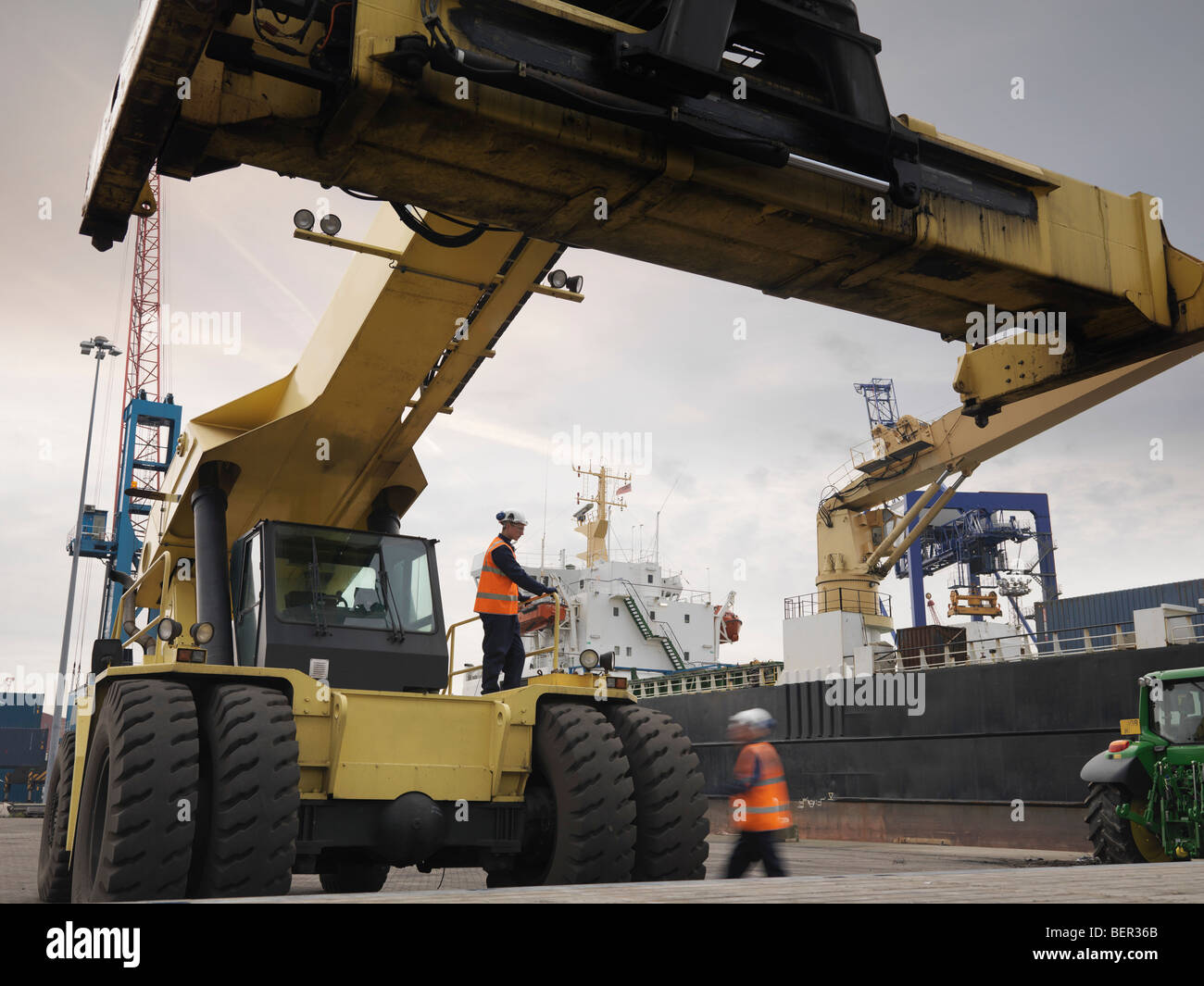 Port Workers With Container Grab - Stock Image