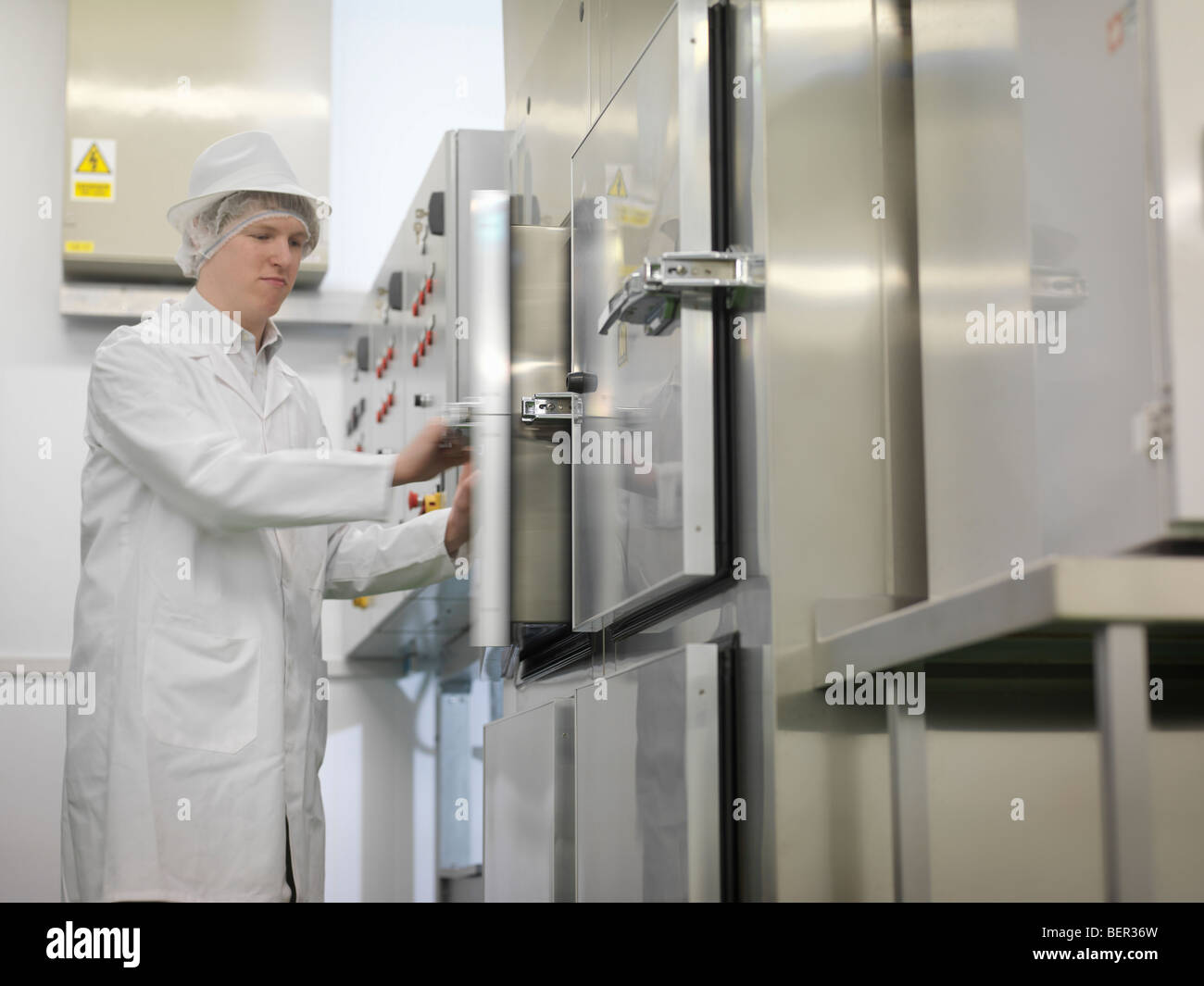 Food Worker At Control Panel - Stock Image