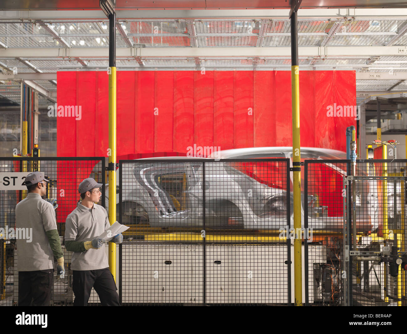 Car Plant Workers & Production Line - Stock Image
