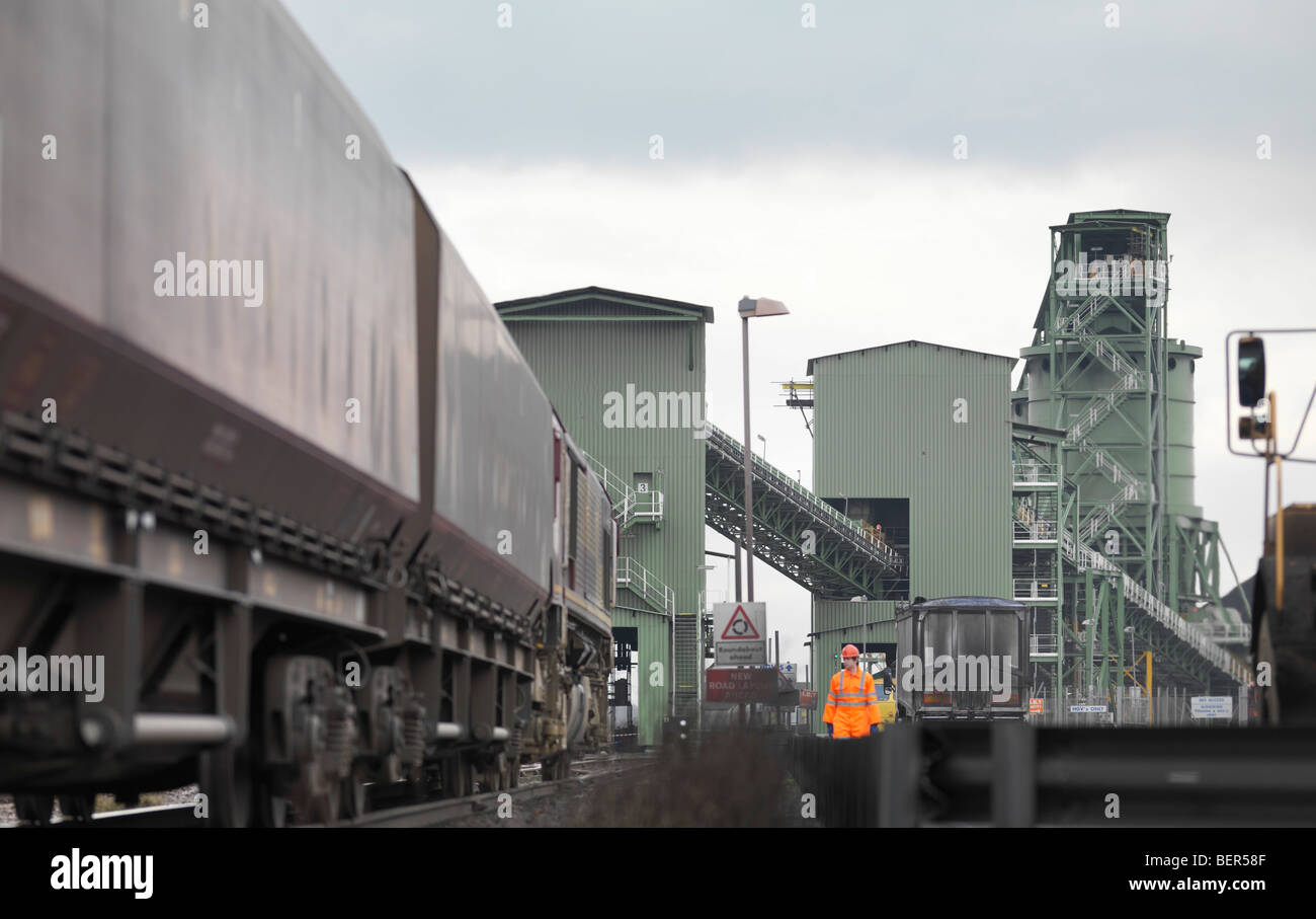 Port Worker Next To Train - Stock Image