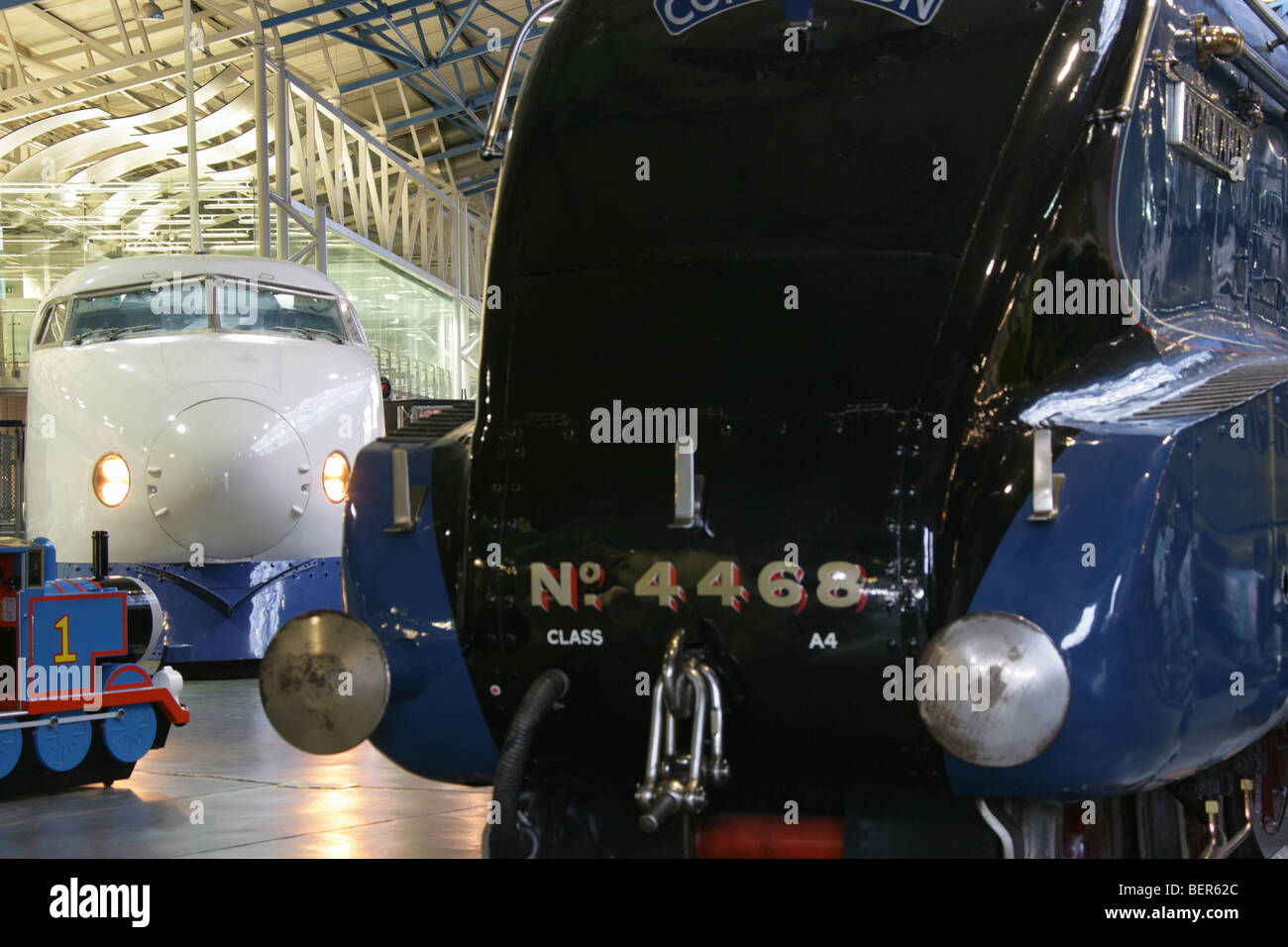 The Shinkansen Bullet Train and Thomas the Tank engine in the background, with the Mallard locomotive engine in - Stock Image