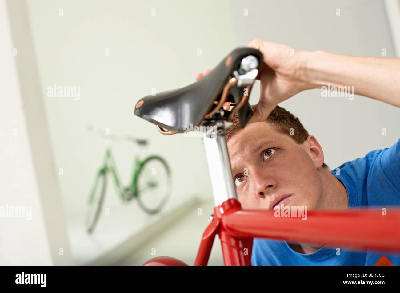 man checking saddle - Stock Image
