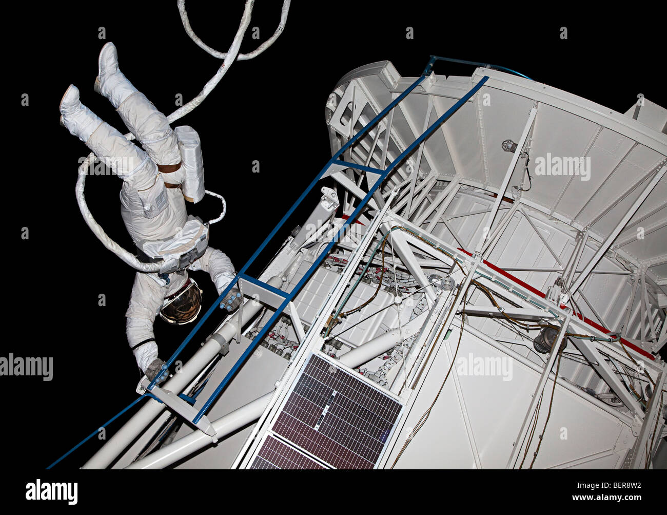 Astronaut on space walk outside space lab in museum exhibit NASA Space Center Houston Texas USA - Stock Image
