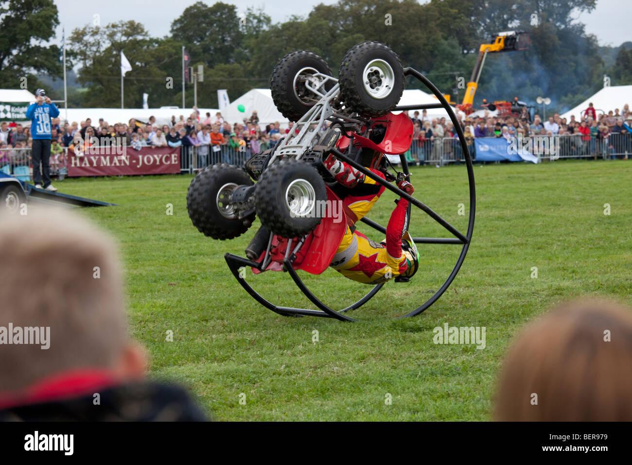 Kangaroo Kid alias Matt Coulter somersaulting on quad stunt bike Moreton Show September 2009 UK Stock Photo