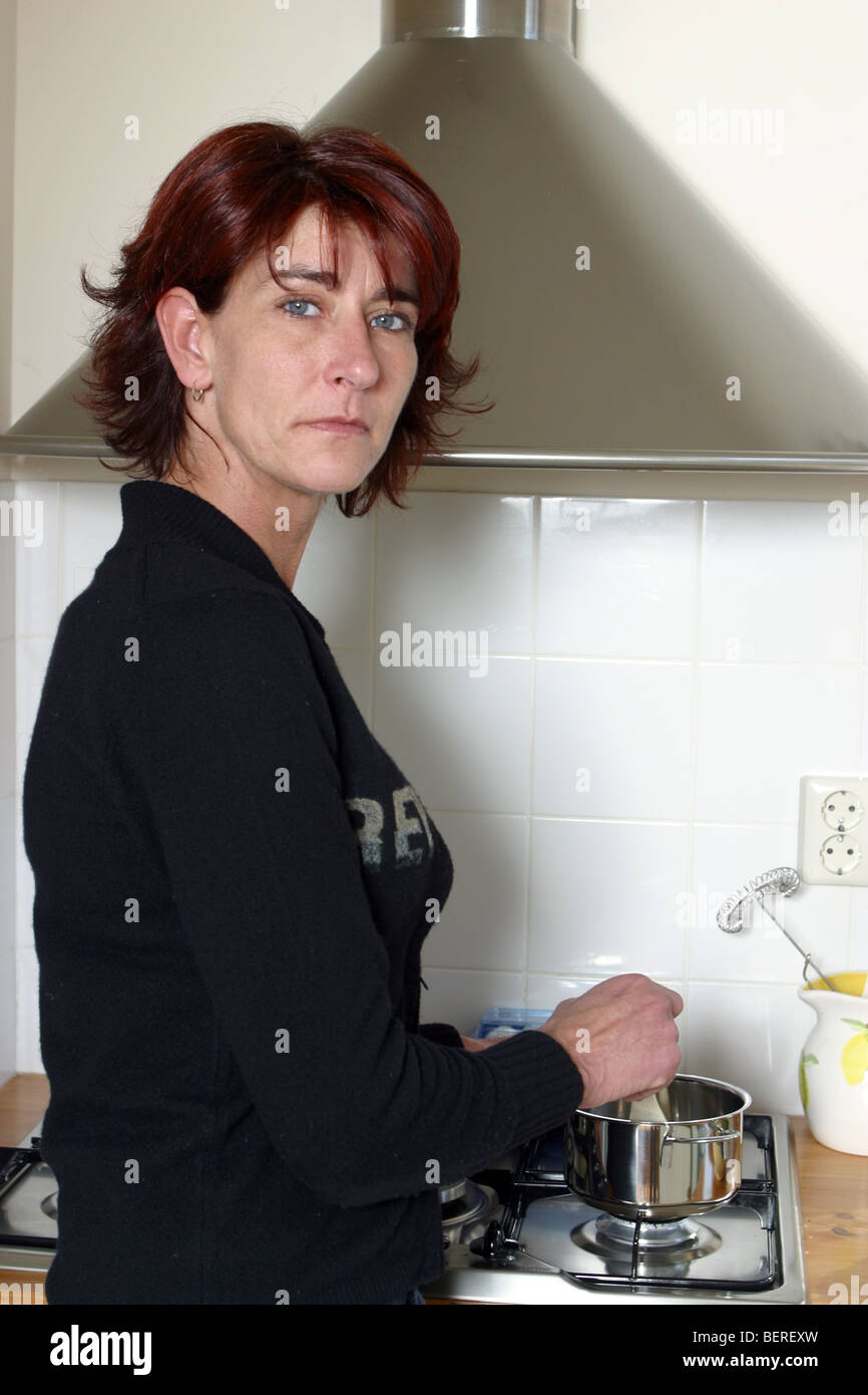 Single own - anorexic cooking in kitchen - Stock Image