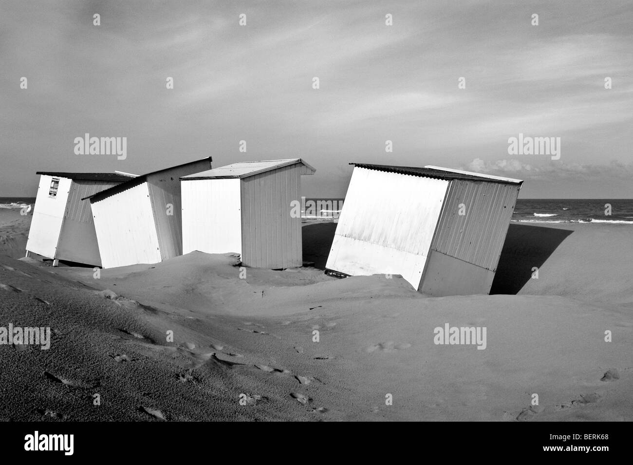 Row of white beach cabins along the North Sea coast at seaside resort Koksijde / Coxyde, West Flanders, Belgium - Stock Image