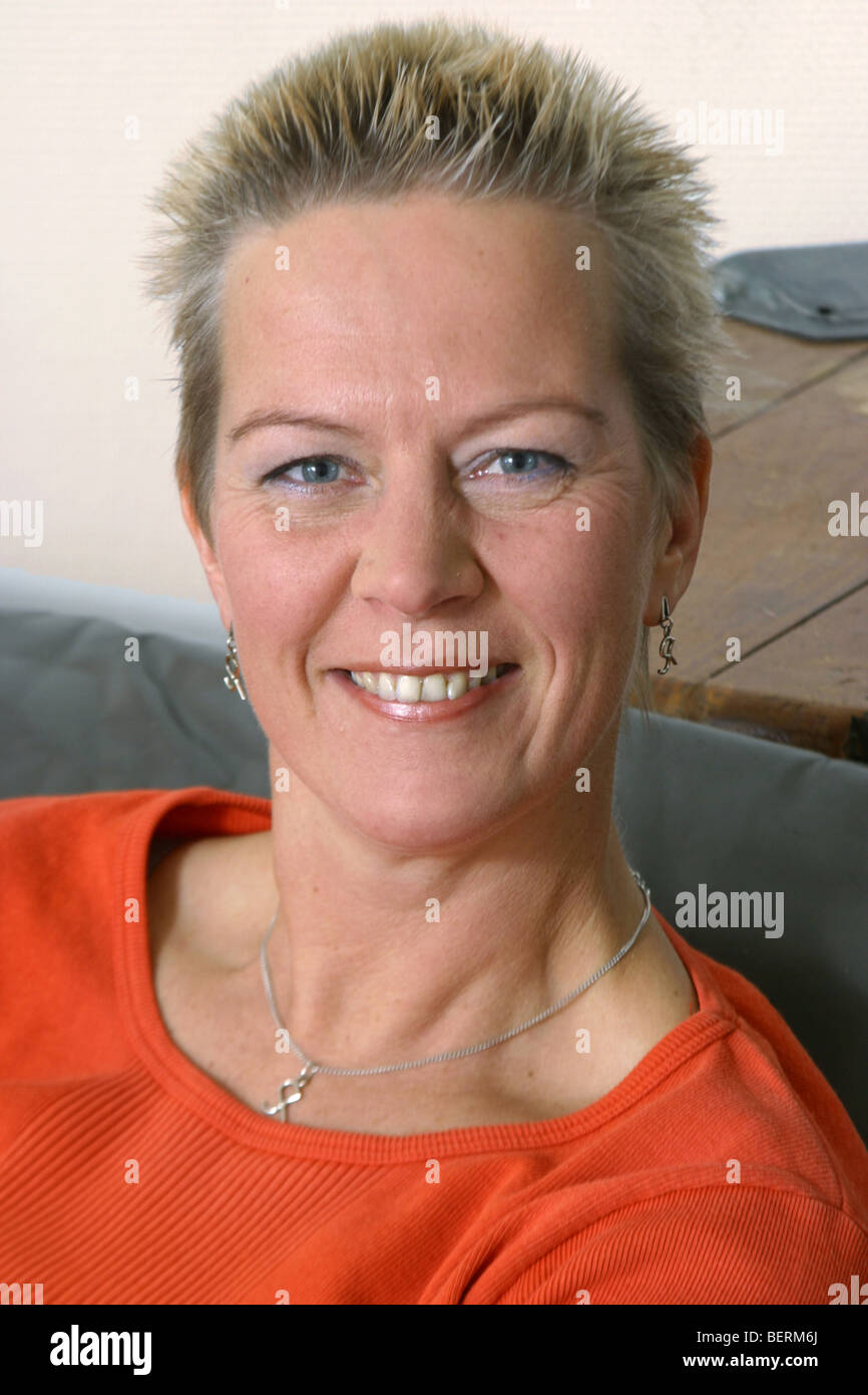 Cheery natural female adult over 40 woman looking at the camera - Stock Image
