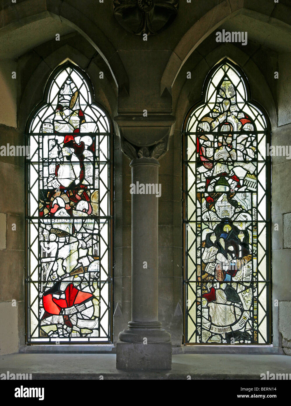 Fragments of Medieval Stained Glass collected in two windows at Church of St Peter, Allexton, Leicestershire - Stock Image
