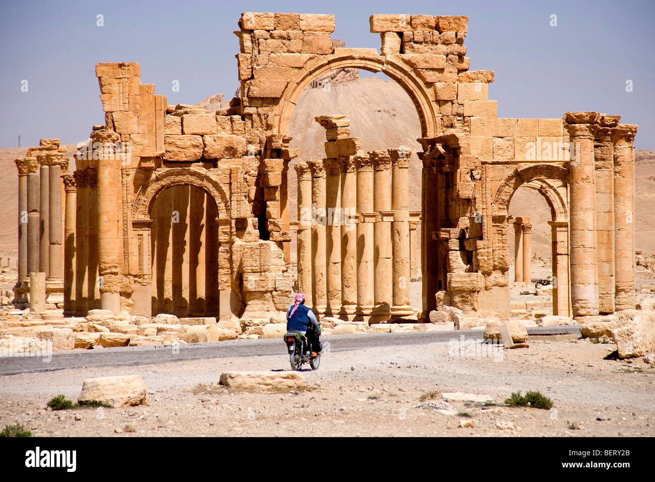 Motorcycle near roman ruins and archaeological site in Palmyra, Syria, Middle East, Asia - Stock Image