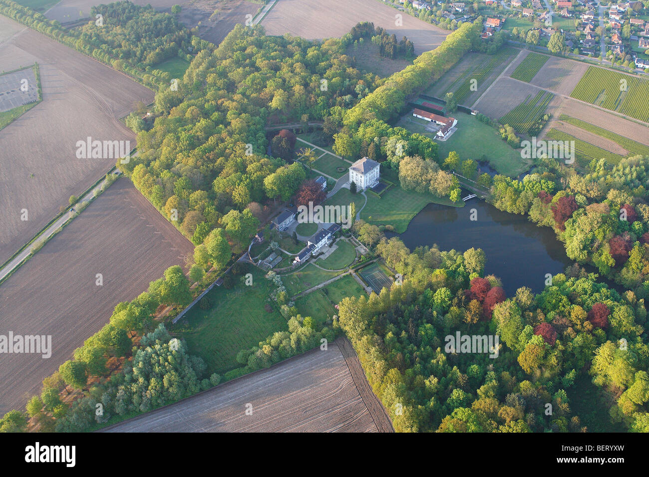 Castle, urbanisation at the border of agricultural area from the air, Belgium - Stock Image