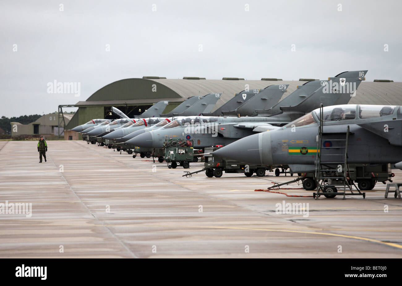 Tornado fighter bomber aircraft lined up at RAF Lossiemouth airbase in Morayshire, Scotland, UK - Stock Image
