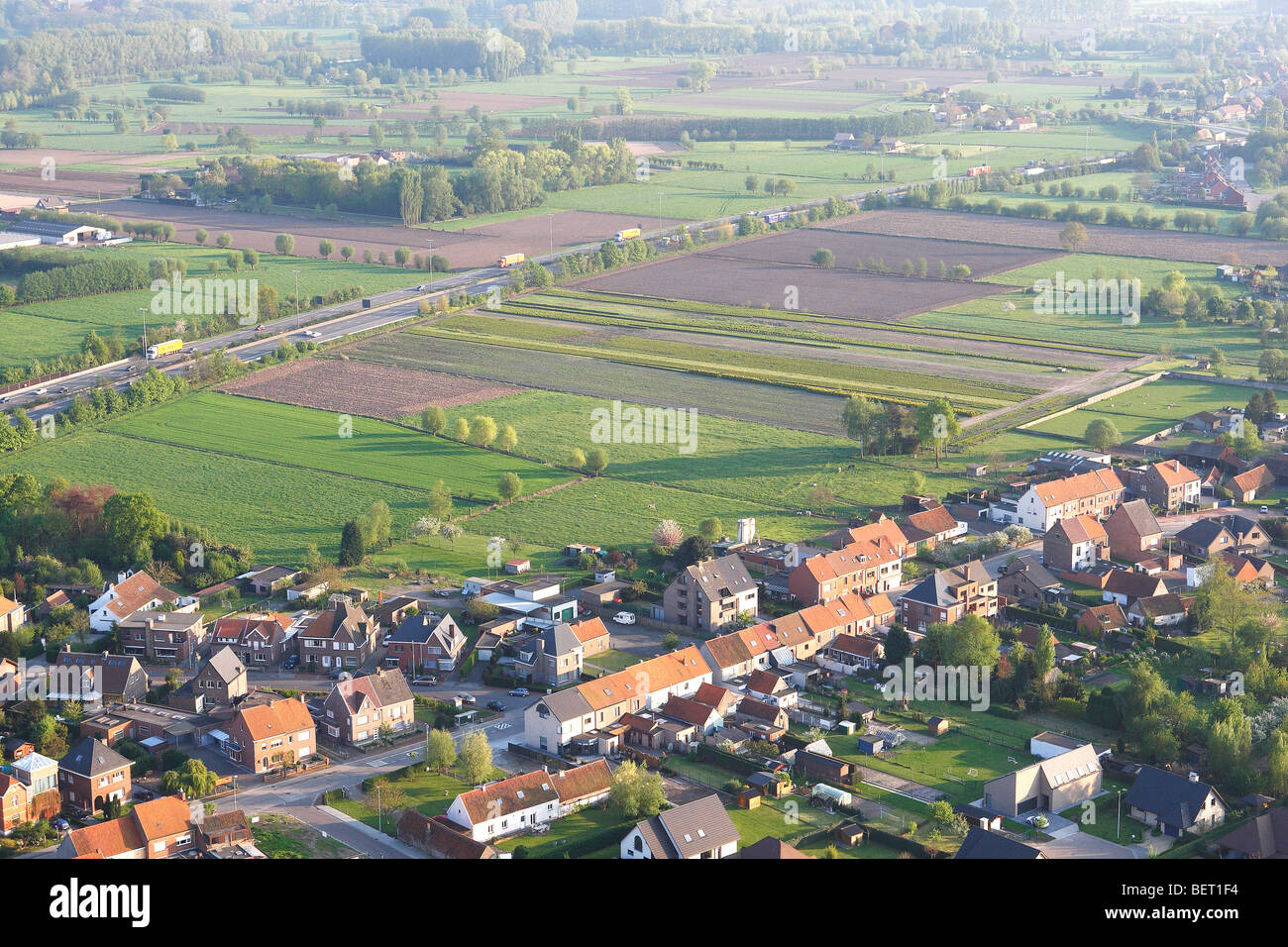 Ribbon development in agricultural area with fields, grasslands and hedges from the air, Belgium - Stock Image