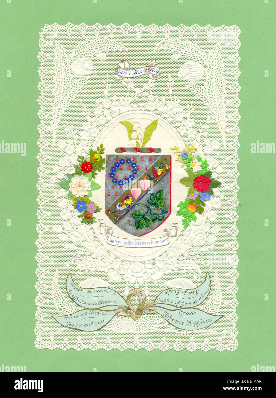 Victorian valentine with coloured scrap on lays.   Titled Love's Heraldry - Stock Image