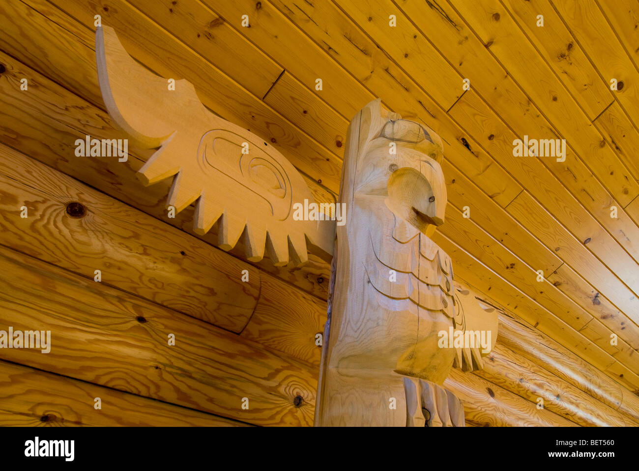 Detail of unpainted totem pole in log cabin interior, International Falls, Minnesota, USA - Stock Image