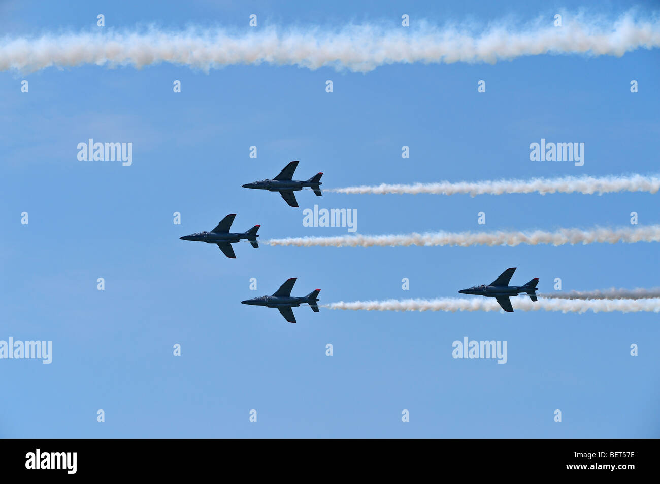Alpha jets flying in formation at the airshow at Koksijde, Belgium - Stock Image