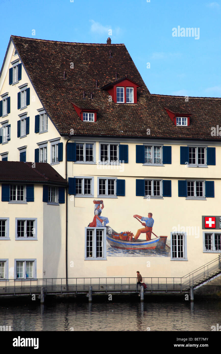 Switzerland, Zurich, painted house, Limmat river - Stock Image