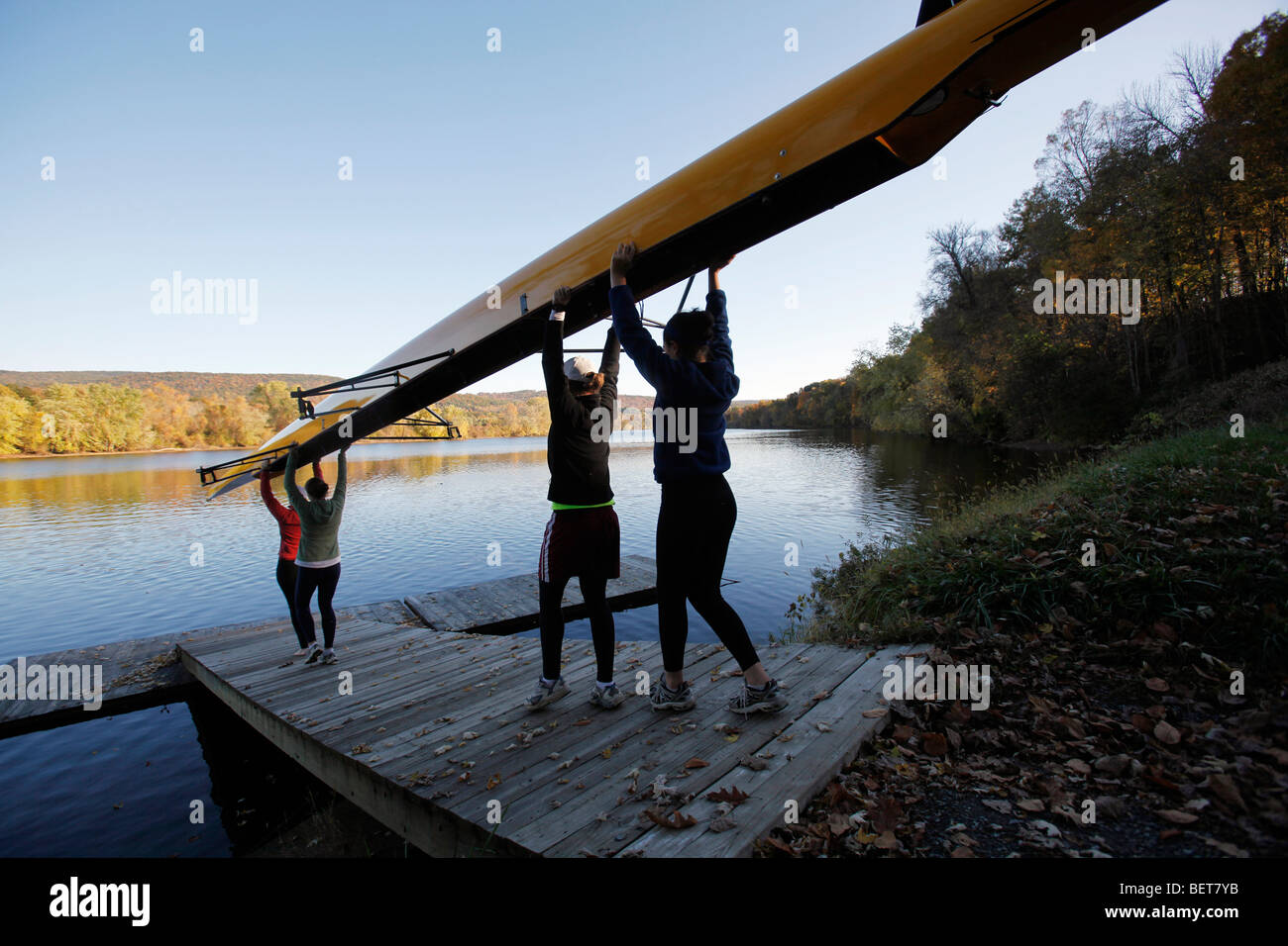 American private high school girls rowing team on the Connecticut River, Gill, Massachusetts - Stock Image