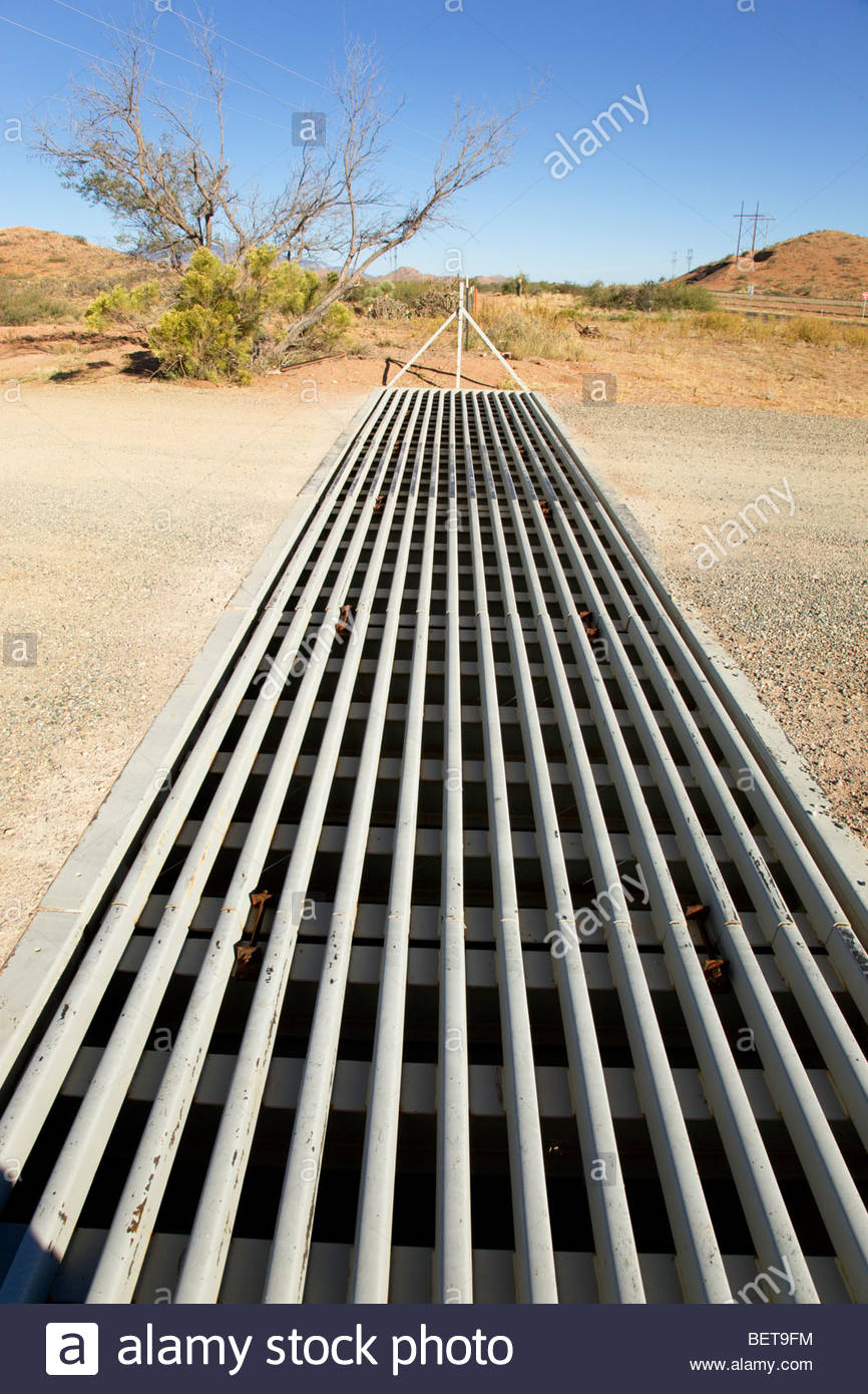 Cattle Guard highway right of way fence - Stock Image