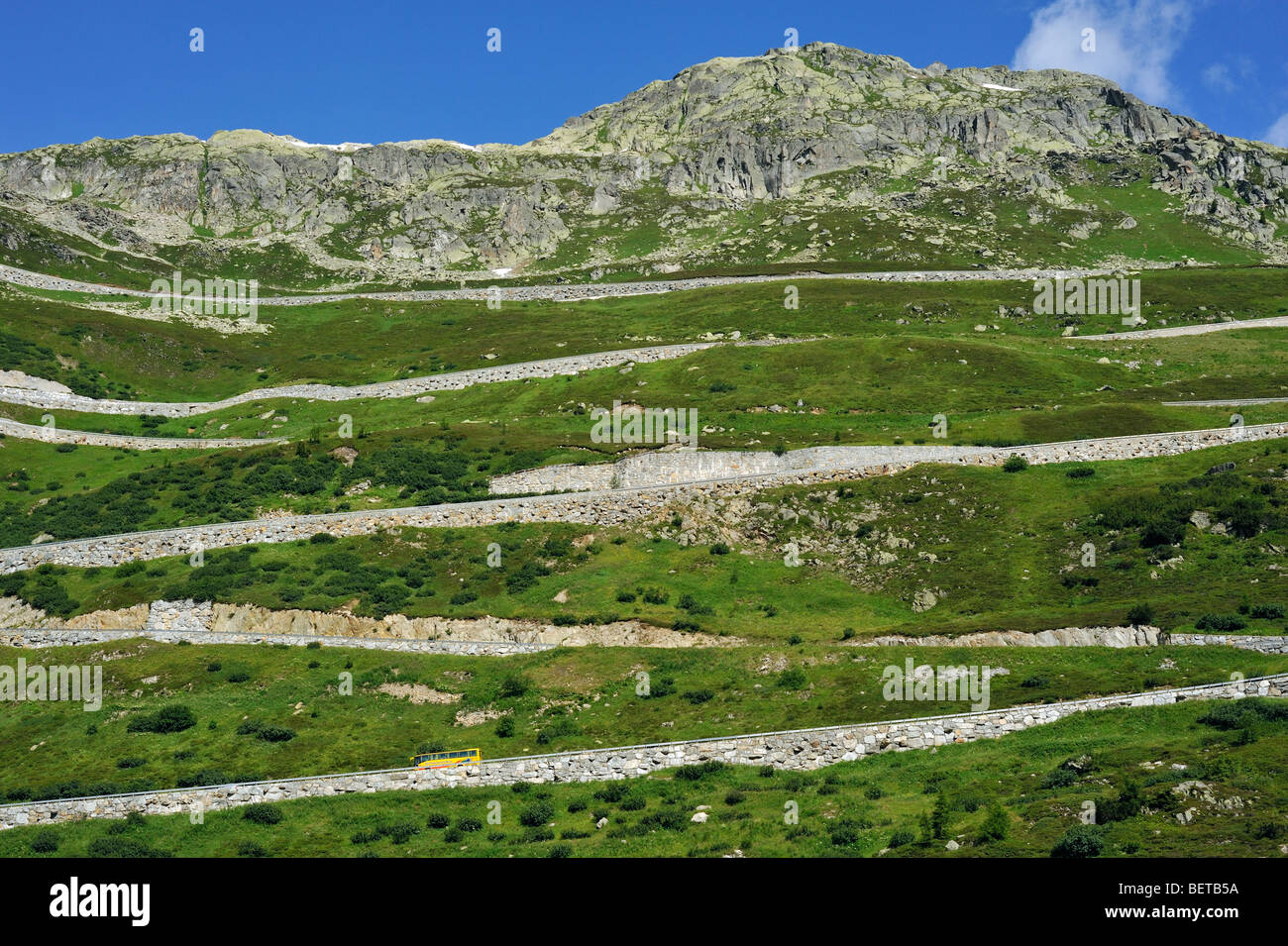 Road with hairpin curves winding over the Grimsel Pass in the Swiss Alps, Switzerland - Stock Image