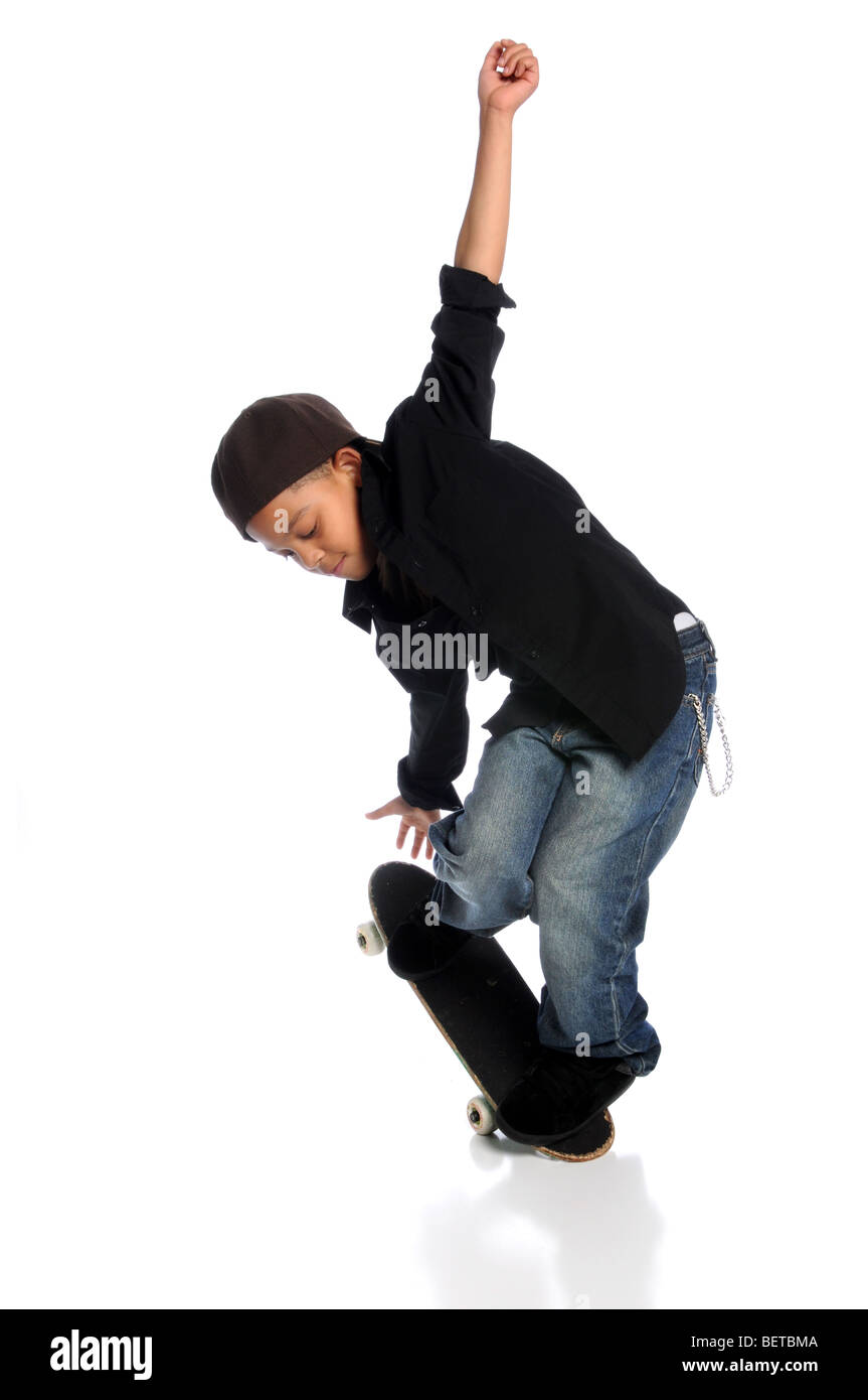 Young African American skateboarder performing trick isolated over white background - Stock Image