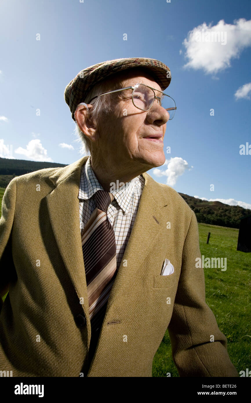Old Man dressed in Tweed with a flat cap Stock Photo  26353438 - Alamy 197739a2fbc