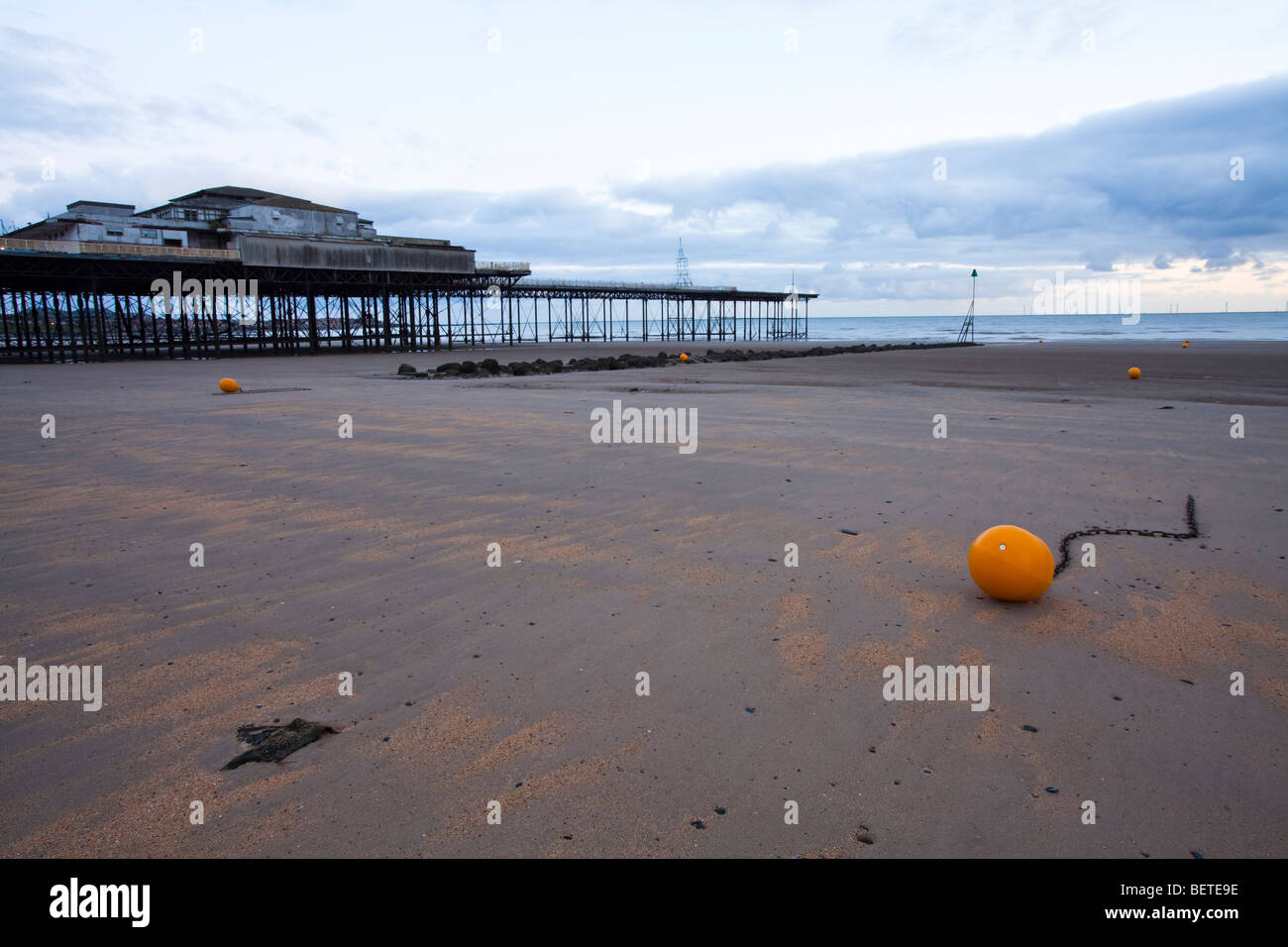 Morning over the deserted and almost derelict Victoria pier at Colwyn Bay in North Wales, UK. - Stock Image