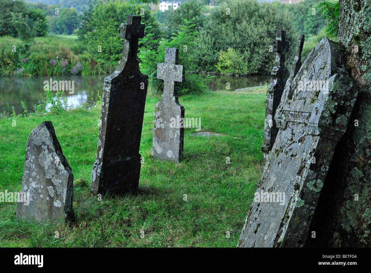 Headstones on graves of the old graveyard along the Semois river at Mortehan, Luxembourg, Wallonia, Belgian Ardennes, - Stock Image